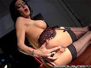ultra-kinky black-haired Jessica Jaymes thumbs her saucy cooch pie in her office