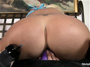 steamy blonde Nikita plays with a purple plaything